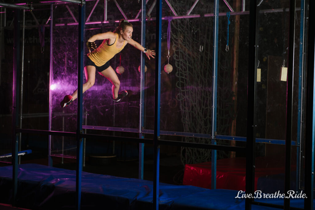 Danielle Thompson in the spider wall at the Compound Training