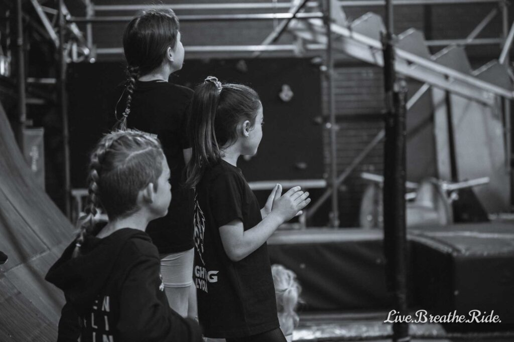kids cheer and support fellow competitors at local ninja competition
