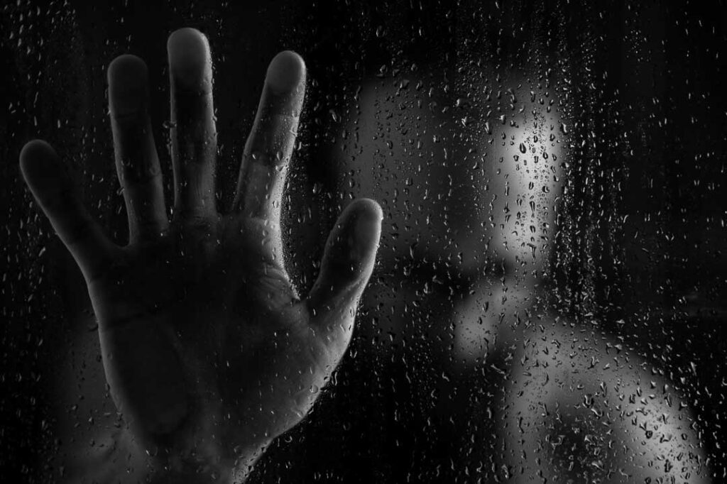 black & white photo of man in a shower, he may be looking to cure depression